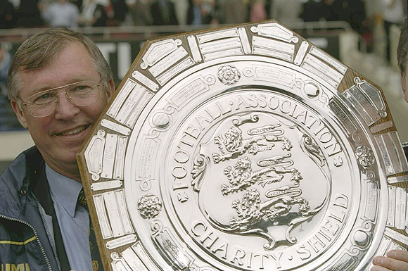 Alex Ferguson, the Manchester United manager holding the FA Charity Shield after victory against Chelsea at Wembley Stadium in London, England