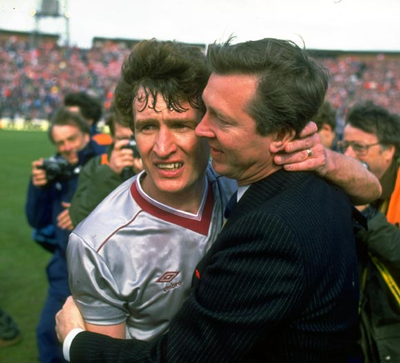 Alex Ferguson Manager of Aberdeen hugs Sandy Jardine (left) of Hearts after winning the Scottish Cup final in Glasgow, in 1986