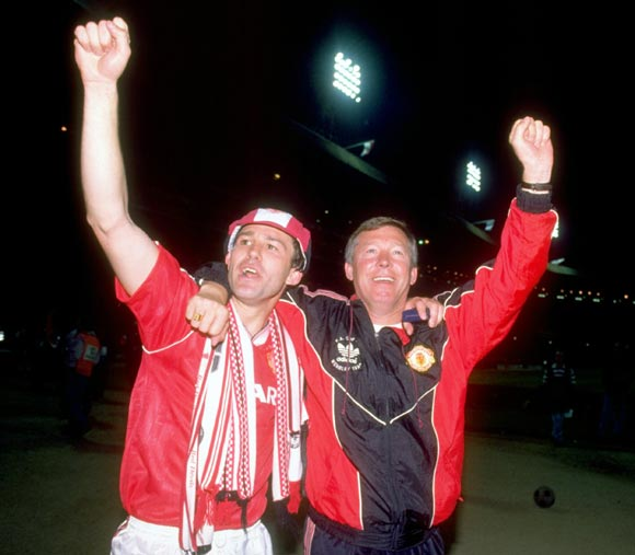 Alex Ferguson (right) and Bryan Robson celebrate after Manchester United won the FA Cup in 1990