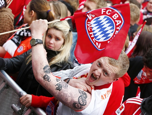Bayern Munich supporters wait for the Bayern team