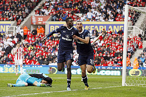 Tottenham Hotspur's Emmanuel Adebayor (centre) celebrates with teammate Steven Caulker after scoring against Stoke City during their English Premier League match at the Britannia Stadium in Stoke-on-Trent, England on Sunday