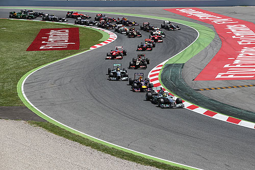 Nico Rosberg of Germany and Mercedes GP leads the field through the first corner at the start of the Spanish Formula One Grand Prix at the Circuit de Catalunya on Sunday