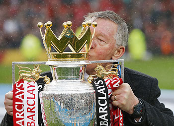 Manchester United manager Alex Ferguson poses with the English Premier League trophy at Old Trafford stadium in Manchester on Sunday. Ferguson's last home match in charge of Manchester United ended in a low-key 2-1 Premier League win over Swansea City as the Old Trafford crowd gave their long-serving manager a warm and emotional send-off on Sunday