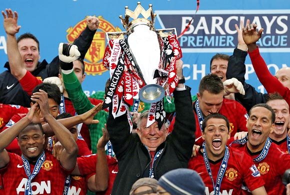 Manchester United manager Alex Ferguson lifts the English Premier League trophy