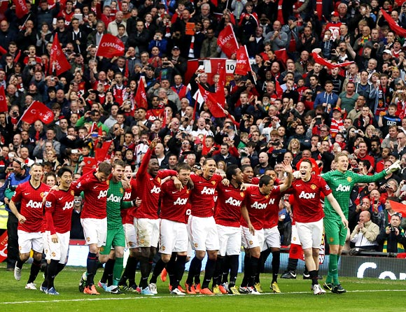 Manchester United players celebrate during the English Premier League trophy presentation ceremony