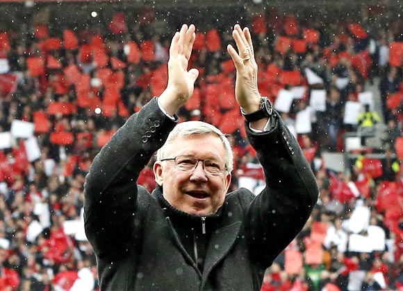 Manchester United manager Alex Ferguson applauds to the crowd