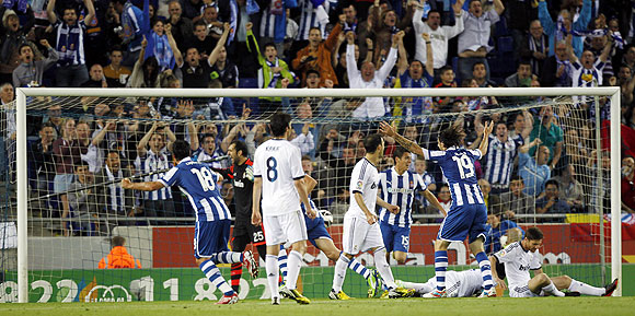 Espanyol's players celebrate a goal against Real Madrid during their La Liga match at Cornella-El Prat stadium on Sunday