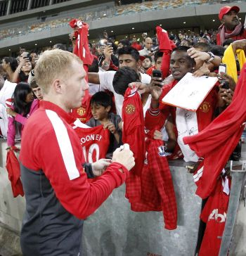 United's Scholes to retire at end of season