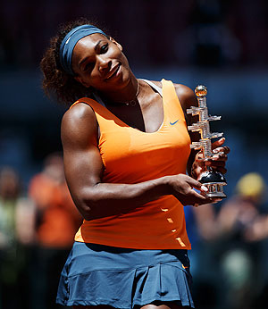 Serena Williams poses with the trophy after defeating Maria Sharapova in the final of the Madrid Open tennis tournament on Sunday