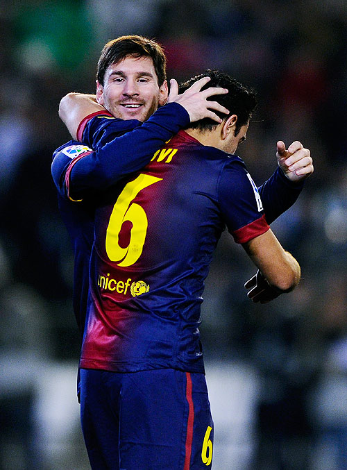 Lionel Messi of FC Barcelona (right) celebrates with teammate Xavi Hernandez