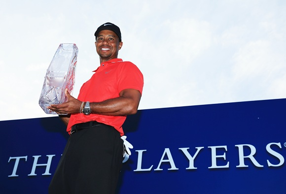 Tiger Woods of the USA holds the winner's trophy