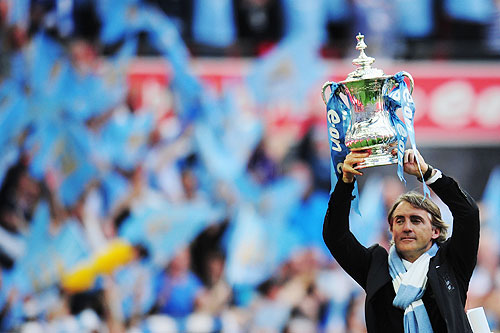 Roberto Mancini lifts the trophy after his Manchester City team wins the FA Cup on May 14, 2011