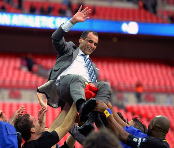 Wigan Athletic manager Roberto Martinez celebrates with his players after winning the FA Cup