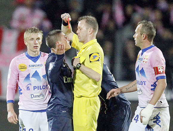 Marco Verratti (2nd from left) of Paris St-Germain receives a red card during their French Ligue 1 soccer match against Evian Thonon Gaillard in Annecy on April 28, 2013