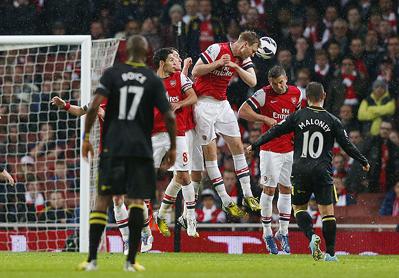 Shaun Maloney of Wigan Athletic scores from a free kick against Arsenal on Tuesday