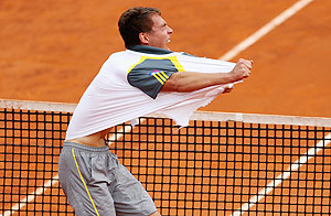 Rediff Sports - Cricket, Indian hockey, Tennis, Football, Chess, Golf - Italian Open: Janowicz stuns Tsonga, Murray injured