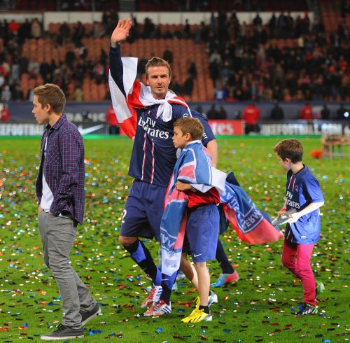avid Beckham waves o the crowd with his sons, Brooklyn, Romeo and Cruz during the Ligue 1 match between Paris Saint-Germain FC and Stade Brestois 29 at Parc des Princes