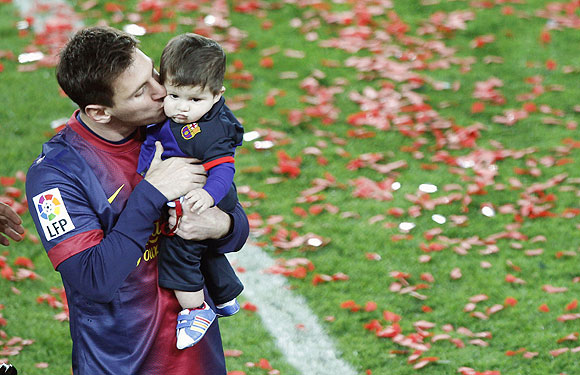 Messi kisses his son Thiago at the presentation ceremony on Sunday