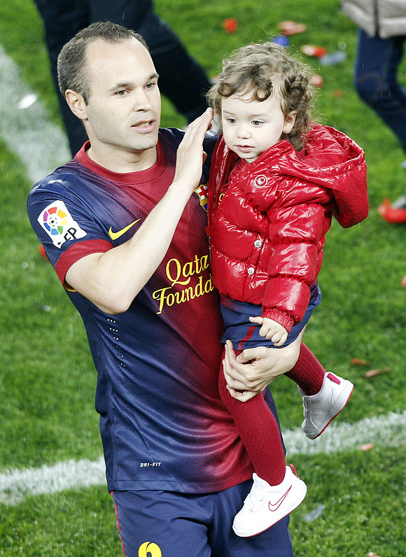 Barcelona's Andres Iniesta with his daughter Valeria during La Liga title celebrations at Camp Nou stadium in Barcelona on Sunday