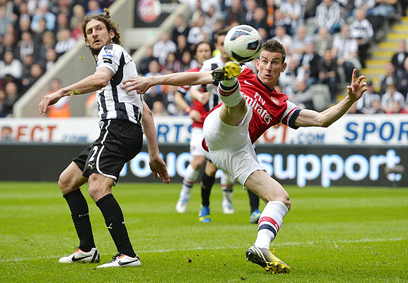 Arsenal's Lourent Koscielny (right) scores against Newcastle United during their English Premier League soccer match at St James' Park in Newcastle on Sunday