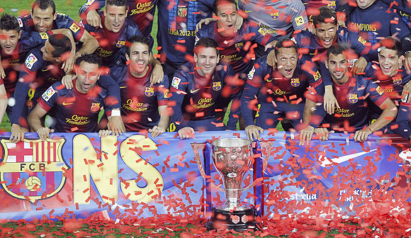 Barcelona's players pose with the La Liga trophy during celebrations at Camp Nou stadium in Barcelona on Sunday