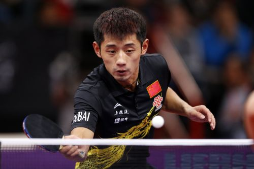 China's Zhang Jike returns the ball during his men's singles final at the World Team Table Tennis Championships in Paris