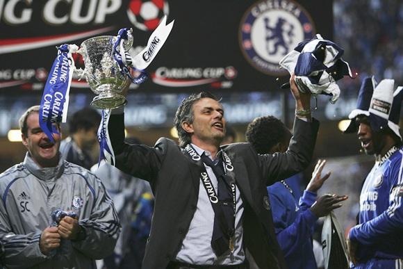 Jose Mourinho celebrates with the trophy