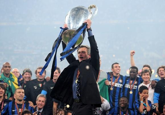 Jose Mourinho the Inter Milan coach holds the trophy aloft