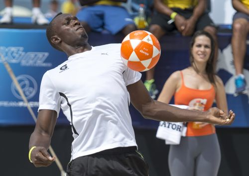 Jamaican Olympic champion Usain Bolt plays footvolley, a combination of soccer and volleyball