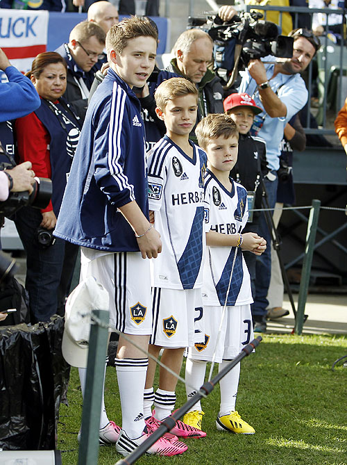 David Beckham's sons Brooklyn (left), Romeo (centre) and Cruz (right)