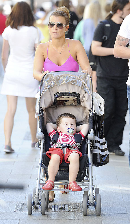 Wife of England soccer player Wayne Rooney, Coleen and son Kai