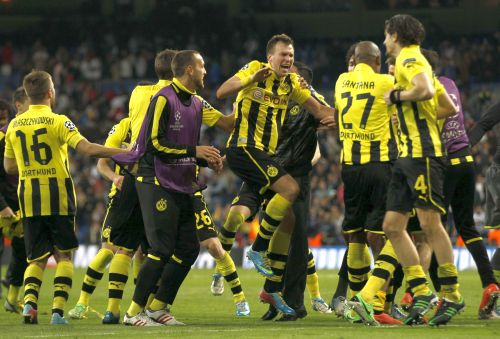 Borussia Dortmund players celebrate after the Champions League semi-final second leg soccer match against Real Madrid