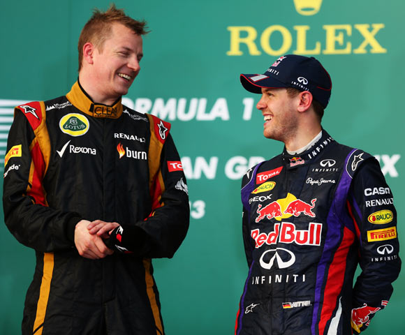 Kimi Raikkonen (left) with Sebastian Vettel