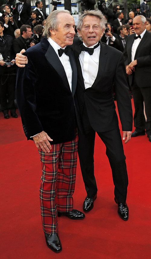 Director Roman Polanski (right) and former Formula One champion driver Jackie Stewart of Britain pose on the red carpet as they arrive for the screening of the film