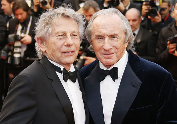 Director Roman Polanski (left) and former Formula One champion driver Jackie Stewart of Britain pose on the red carpet as they arrive for the screening of the film