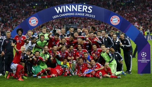 Bayern Munich players and staff celebrate with the trophy after winning the Champions League final soccer match at Wembley stadium