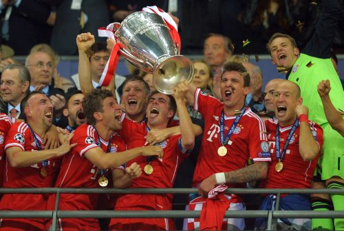 Philipp Lahm of Bayern Muenchen lifts the trophy after winning the UEFA Champions League final match against Borussia Dortmund at Wembley Stadium