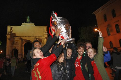 Bayern Munich supporters celebrate after their teams victory in Champions League finals against Borussia Dortmund