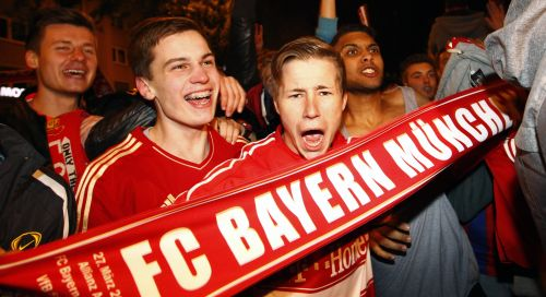 Supporters of Bayern Munich react after their teams win over Borussia Dortmund in Champions League final
