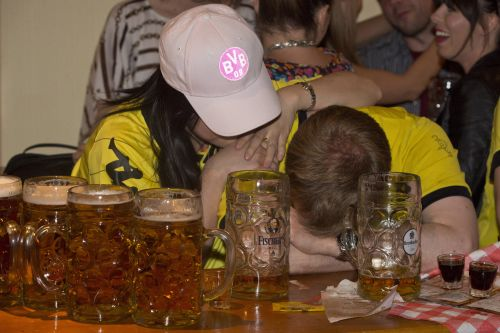 Borussia Dortmund fans in a Bavarian bar in London react as their team loses 2 -1 against Bayern Munich