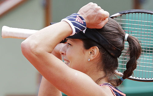 Ana Ivanovic of Serbia celebrates after defeating Petra Martic of Croatia in their first round match of the French Open at the Roland Garros on Sunday