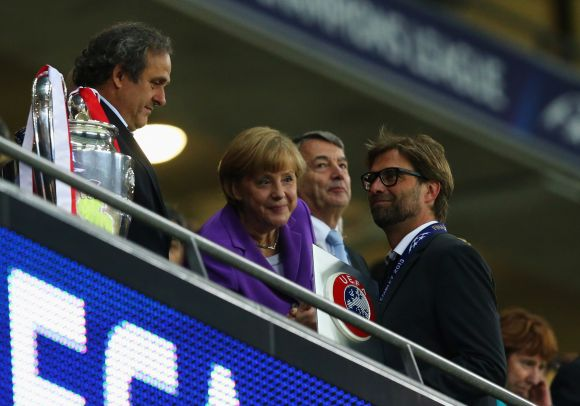UEFA President Michel Platini, German Chancellor Angela Merkel and President of the German Football Association Wolfgang Niersbach offer their commiserations to Head Coach Jurgen Klopp