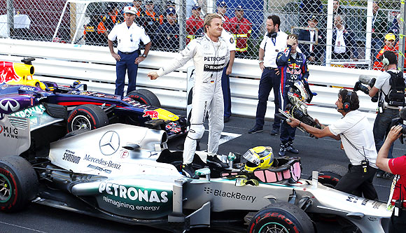 Mercedes Formula One driver Nico Rosberg of Germany celebrates near Red Bull driver Sebastian Vettel of Germany after winning the Monaco F1 Grand Prix on Sunday