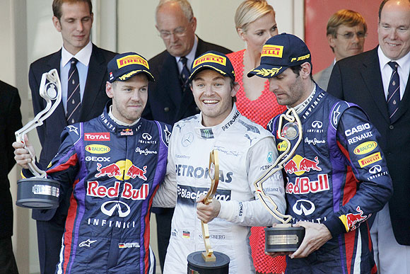 Mercedes'Nico Rosberg celebrates next to Red Bull's Sebastian Vettel (2nd) and Mark Webber (3rd) after winning the Monaco F1 Grand Prix on Sunday