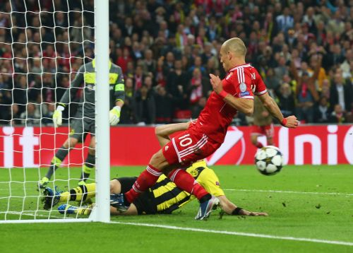Neven Subotic of Borussia Dortmund (L) clears the ball off the line as Arjen Robben of Bayern Muenchen attempts a shot during the UEFA Champions League final match between Borussia Dortmund and FC Bayern Muenchen at Wembley Stadium