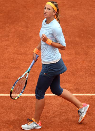 Victoria Azarenka of Belarus celebrates a point in her match against Elena Vesnina of Russia