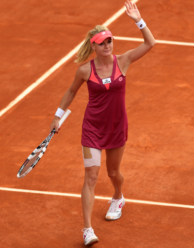 Agnieszka Radwanska of Poland waves to the crowd after victory