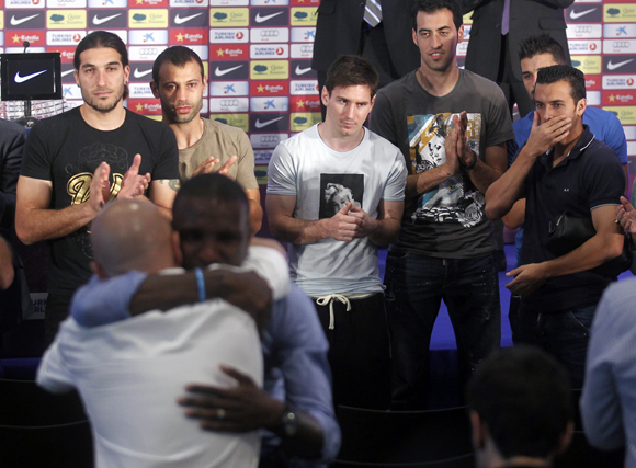 Barcelona's soccer player Eric Abidal reacts during a news conference at Camp Nou