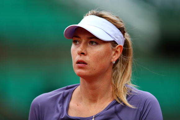 Maria Sharapova of Russia looks on during her match against Eugenie Bouchard of Canada