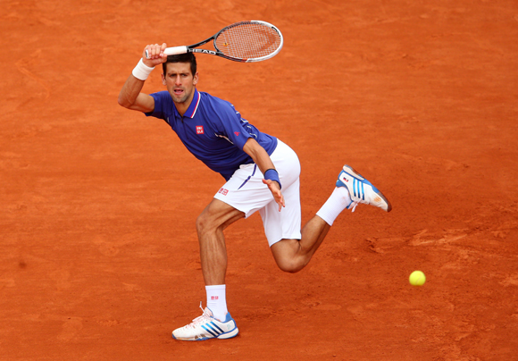 Novak Djokovic of Serbia plays a forehand in his match against Gui